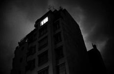Dark building with black sky