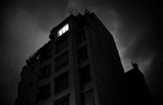 Dark building with black sky